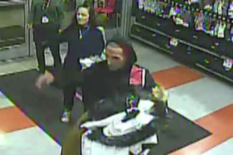 Police are looking for two suspects accused of taken six North Face jackets without paying from Dick's Sporting Goods on Universal Drive in North Haven, Conn. Police said the theft happened on Nov. 4, 2019. Photo: Contributed Photo / North Haven Police Department