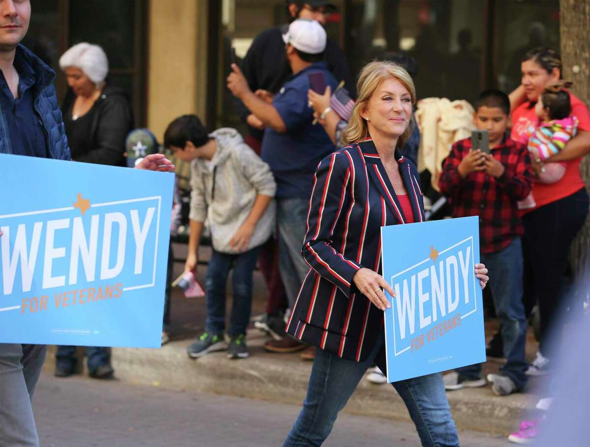 Wendy Davis, the former Texas senator now running for U.S. Congress, takes part in the U.S. Veterans Day Parade Association's 20th annual Veterans Day parade through downtown San Antonio on Saturday, Nov. 9, 2019. Prior to the parade, a wreath presentation honoring veterans from all military branches including a flyover of a C-5 aircraft from the 433rd Airlift Wing occurred at the Alamo. About 100 parade entries, including floats and bands and cars took part in the celebration that started by the Express-News building and finished by Milam Park where a festival with vendors took place. (Kin Man Hui/San Antonio Express-News)