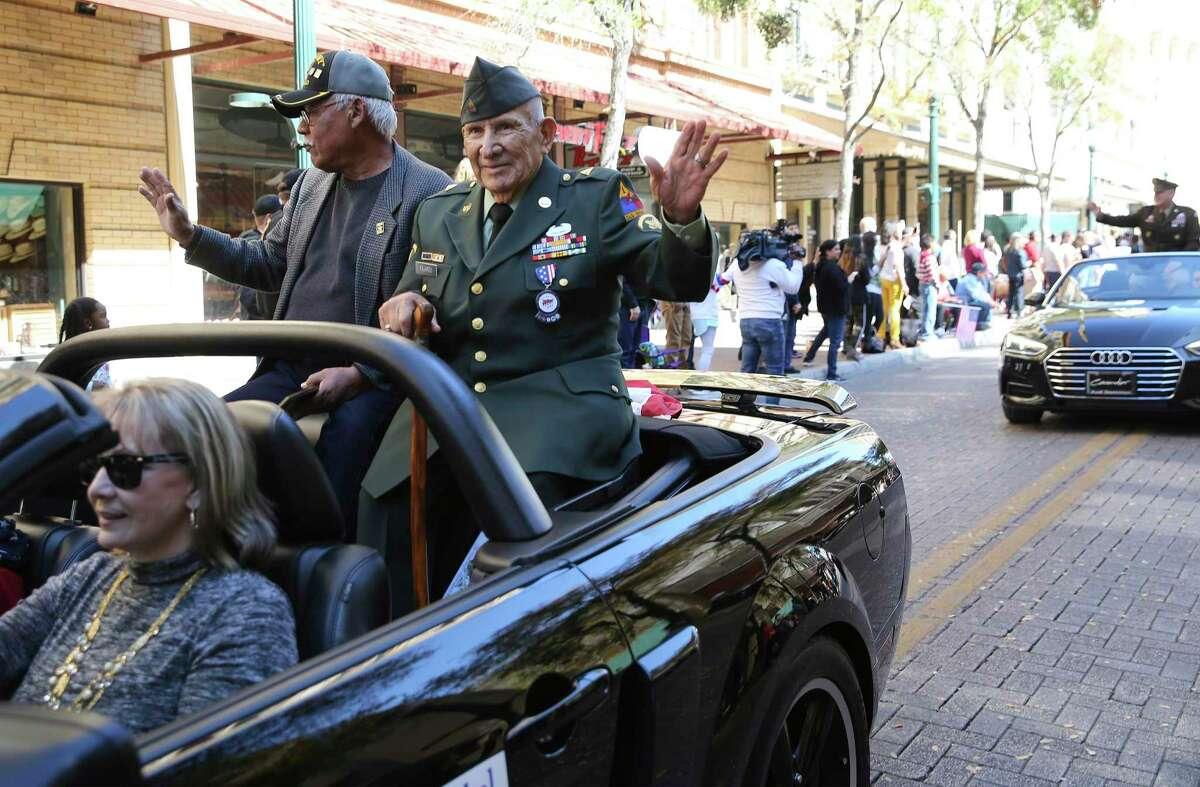 Honorary Grand Marshal Tomas Fajardo (right), a World War II, Korea and Vietnam veteran, waves to the crowd during the U.S. Veterans Day Parade Association's 20th annual Veterans Day parade through downtown San Antonio on Saturday, Nov. 9, 2019. (Kin Man Hui/San Antonio Express-News)