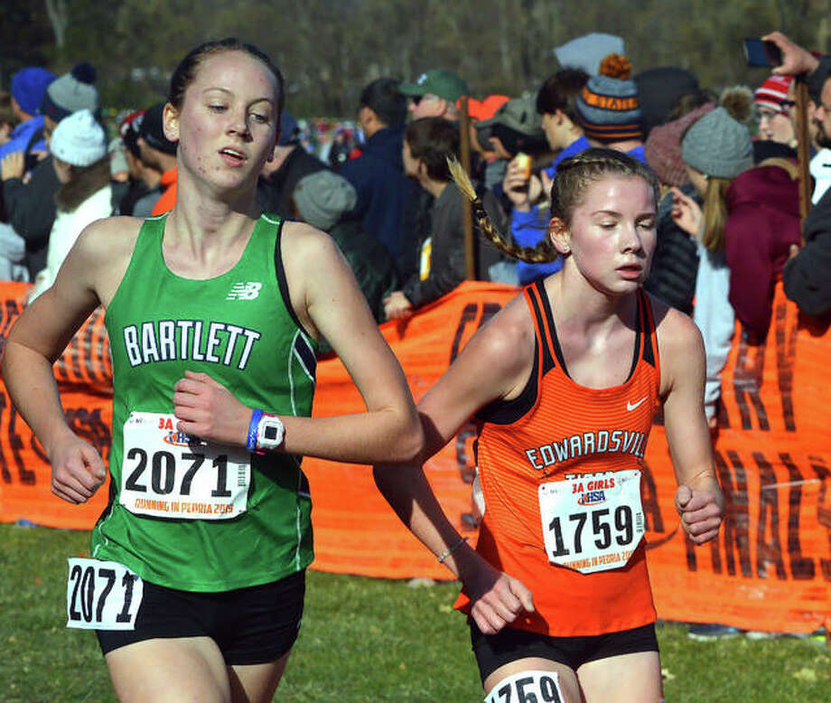 Edwardsville's Riley Knoyle, right, heads toward the finish line during Saturday's Class 3A state meet at Detweiller Park in Peoria. Photo: Scott Marion/The Intelligencer