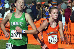 Edwardsville's Riley Knoyle, right, heads toward the finish line during Saturday's Class 3A state meet at Detweiller Park in Peoria.