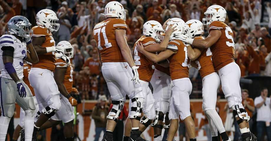 AUSTIN, TX - NOVEMBER 09:  The Texas Longhorns congratulate Cameron Dicker #17 after a game winning field goal against the Kansas State Wildcats at Darrell K Royal-Texas Memorial Stadium on November 9, 2019 in Austin, Texas.  (Photo by Tim Warner/Getty Images) Photo: Tim Warner/Getty Images
