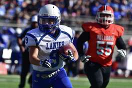 Lanier running back Ricky Torres scrambles for yardage against Burbank's Guillermo Ortiz in the second quarter of their game at Alamo Stadium on Saturday.