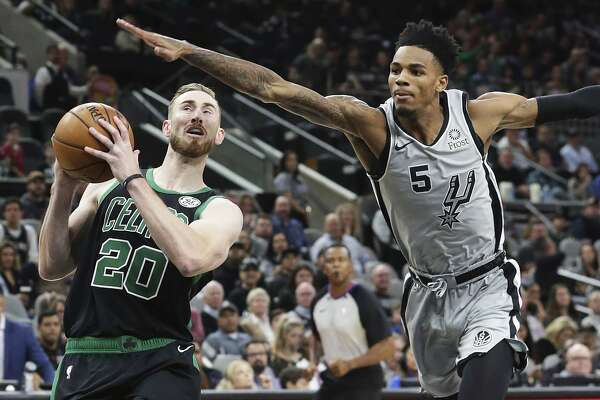Dejounte Murray tries to keep Gordon Hayqard from getting to the hoop as the Spurs hosts the Celtics at the AT&T Center on Nov. 9, 2019.