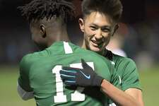 Shenendehowa's Toba Akinyemi ,left, Rhys Hourmont celebrate a 3-1 win against Baldwinsville and during a boysA?• Class AA State quarterfinal high school soccer game Saturday, November 9, 2019, in Colonie, N.Y. (Hans Pennink / Special to the Times Union)