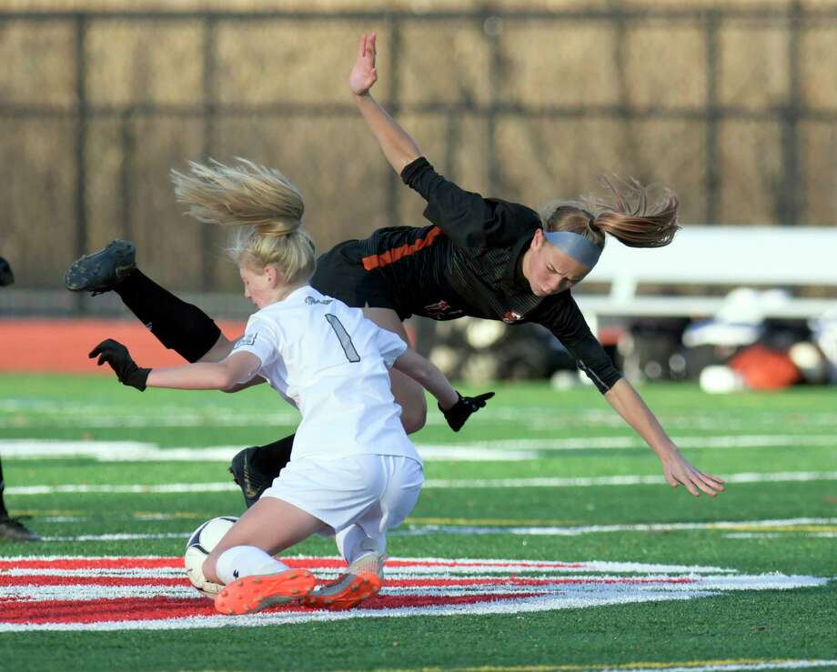 Fayetteville-Manlius' Chloe Hodge (1) collides with Bethlehem's Claire Hutton (11) during a girlsA• Class AA State quarterfinal high school soccer game Saturday, November 9, 2019, in Mechanicville, N.Y. (Hans Pennink / Special to the Times Union) Photo: Hans Pennink / Hans Pennink
