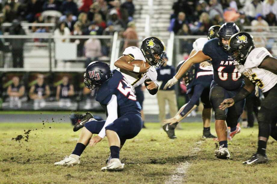 Liberty junior Alijah Terrell runs through traffic against a stingy Hardin-Jefferson football team in Friday night's district loss, 26-7. The Panthers season ends with the loss. Photo: David Taylor / Staff Photo