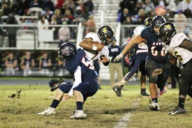 Liberty junior Alijah Terrell runs through traffic against a stingy Hardin-Jefferson football team.