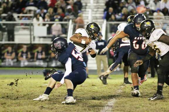 Liberty junior Alijah Terrell runs through traffic against a stingy Hardin-Jefferson football team.