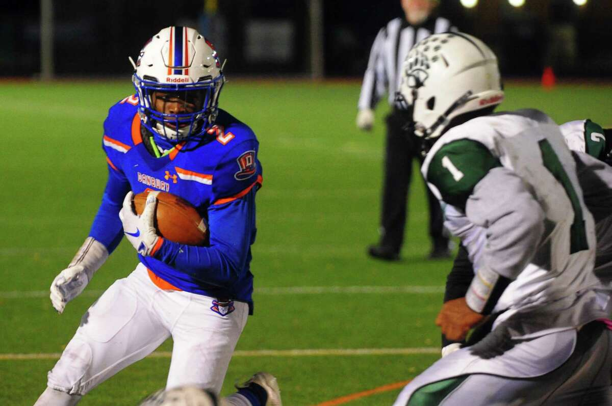 Danbury's Malachi Hopkins (2) heads to the end zone as Norwalk's Camryn Edwards (1) converges to tackle during football action against Norwalk in Fairfield, Conn., on Saturday Nov. 9, 2019. Hopkins scored a touchdown in the play.