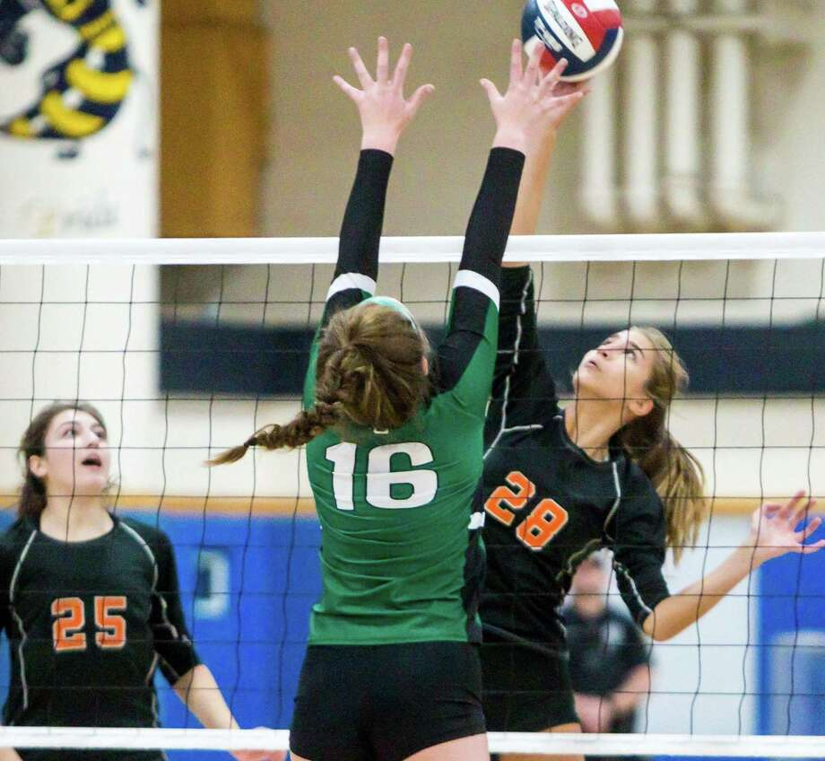 Shelton's Greta Gelumbickas goes for a kill over Guilford's Emily Brouder during the SCC championship on Saturday. Photo: John Vanacore / For Hearst Connecticut Media / (c)John H.Vanacore