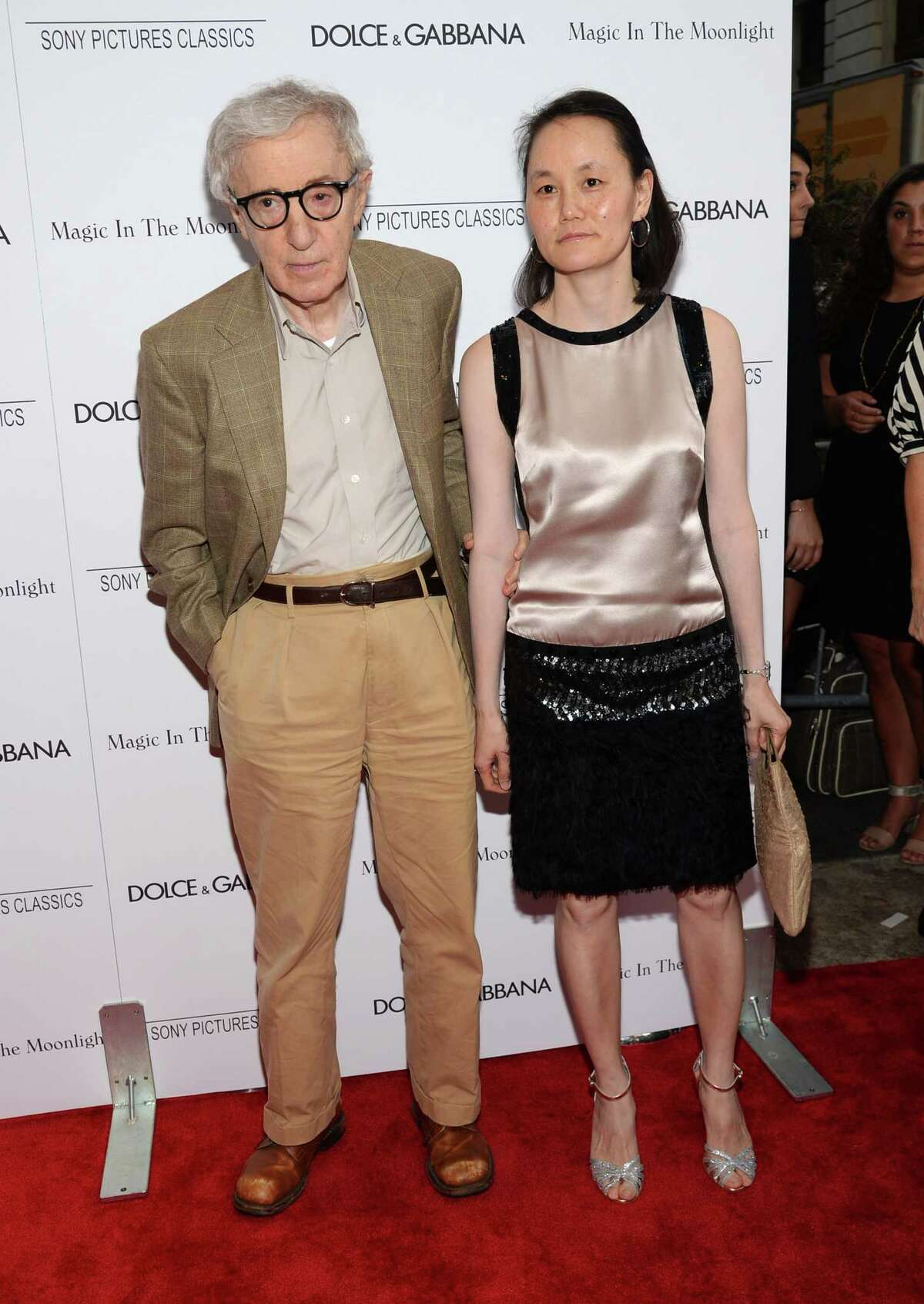 In this Thursday, July 16, 2014 photo, Writer/Director Woody Allen and Soon-Yi Previn arrive at the premiere of