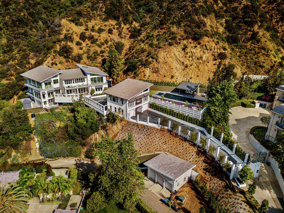 Rapper Tyga has inked a deal to lease a newly built home in Bel-Air for $58,000 a month. The roughly 13,000-square-foot house extends horizontally across a hillside lot of nearly two acres. Features include high ceilings, rows of French doors and picture windows that take in sweeping canyon views. (Noel Kleinman) Photo: Neol Kleinman / Los Angeles Times
