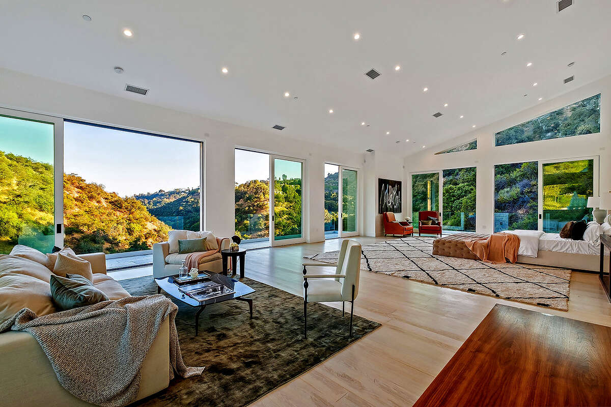 Rapper Tyga has inked a deal to lease a newly built home in Bel-Air for $58,000 a month. The roughly 13,000-square-foot house extends horizontally across a hillside lot of nearly two acres. Features include high ceilings, rows of French doors and picture windows that take in sweeping canyon views. (Noel Kleinman)