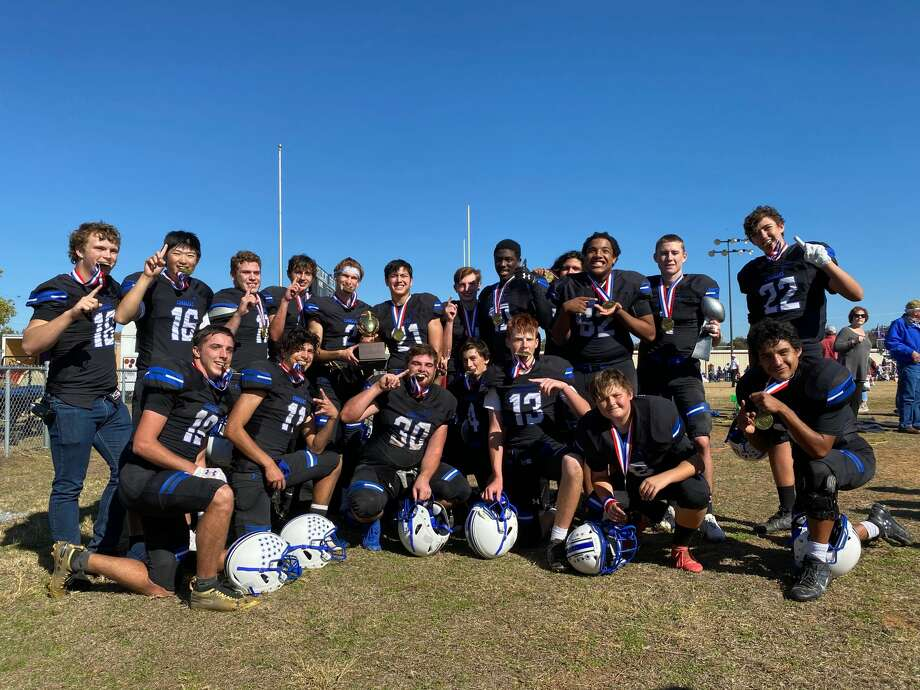 The Trinity football team poses for a team picture after beating the Tyler Heat, 28-19, in a Texas Six-Man Football Independent Bowl Game, Saturday in Gholson. Photo: Courtesy Photo