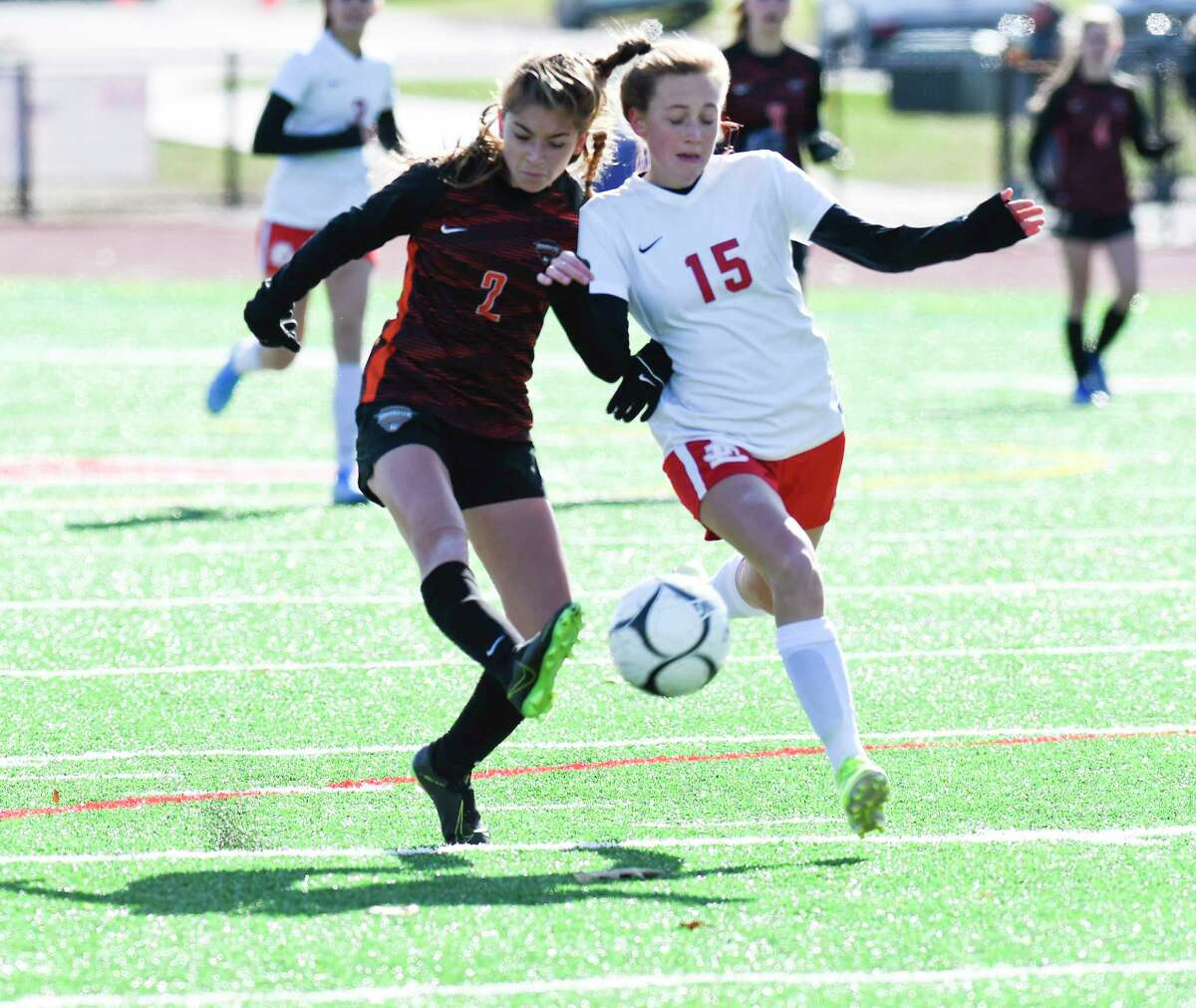 Mohonasen's Liv Raucci (2) challenges Jamesville-DeWitt's Alice OA?•Connor (15) for the ballduring a girlsA?• Class A State quarterfinal high school soccer game Saturday, November 9, 2019, in Mechanicville, N.Y. Jamesville-DeWitt won after 3-2 shoot-out to advance. (Hans Pennink / Special to the Times Union)