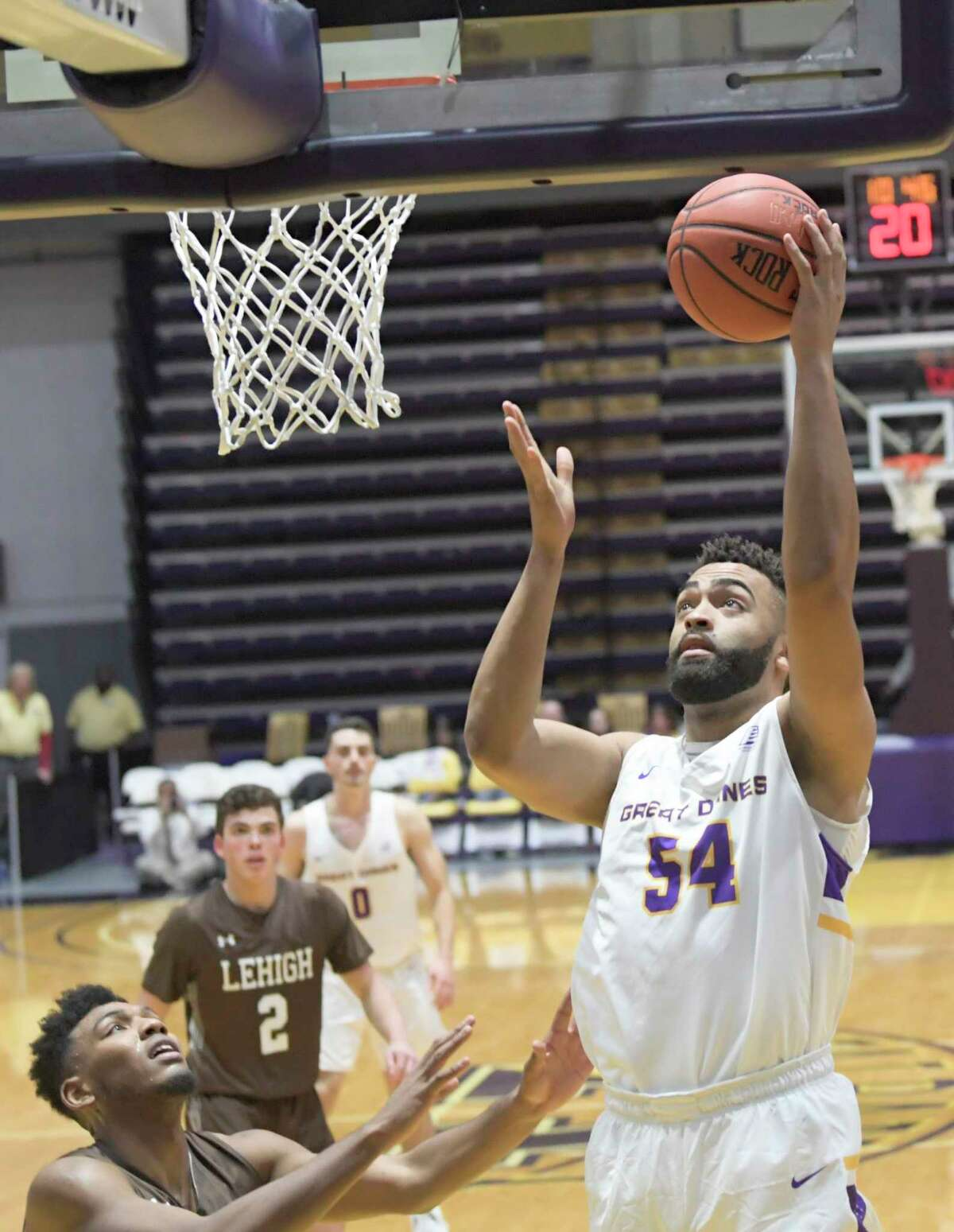University at Albany forward Kendall Lauderdale (54) scores against Lehigh during the second half of their home opener NCAA basketball game Saturday, Nov. 9, 2019, in Albany, N.Y. Lehigh won 74-70.