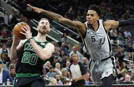 Dejounte Murray tries to keep Gordon Hayward from getting to the hoop.