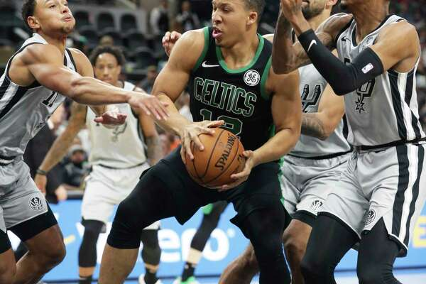 The Spurs defense sags in to try to stop Grant Williams as the Spurs hosts the Celtics at the AT&T Center on Nov. 9, 2019.