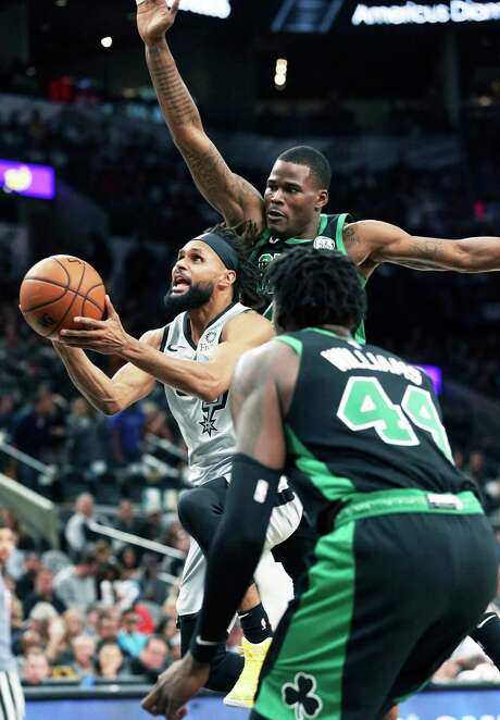Patty Mills, slipping past the Celtics' Javonte Green on Saturday, leads the Spurs with 12.6 points off the bench after the led Australia in scoring during the FIBA World Cup this summer.