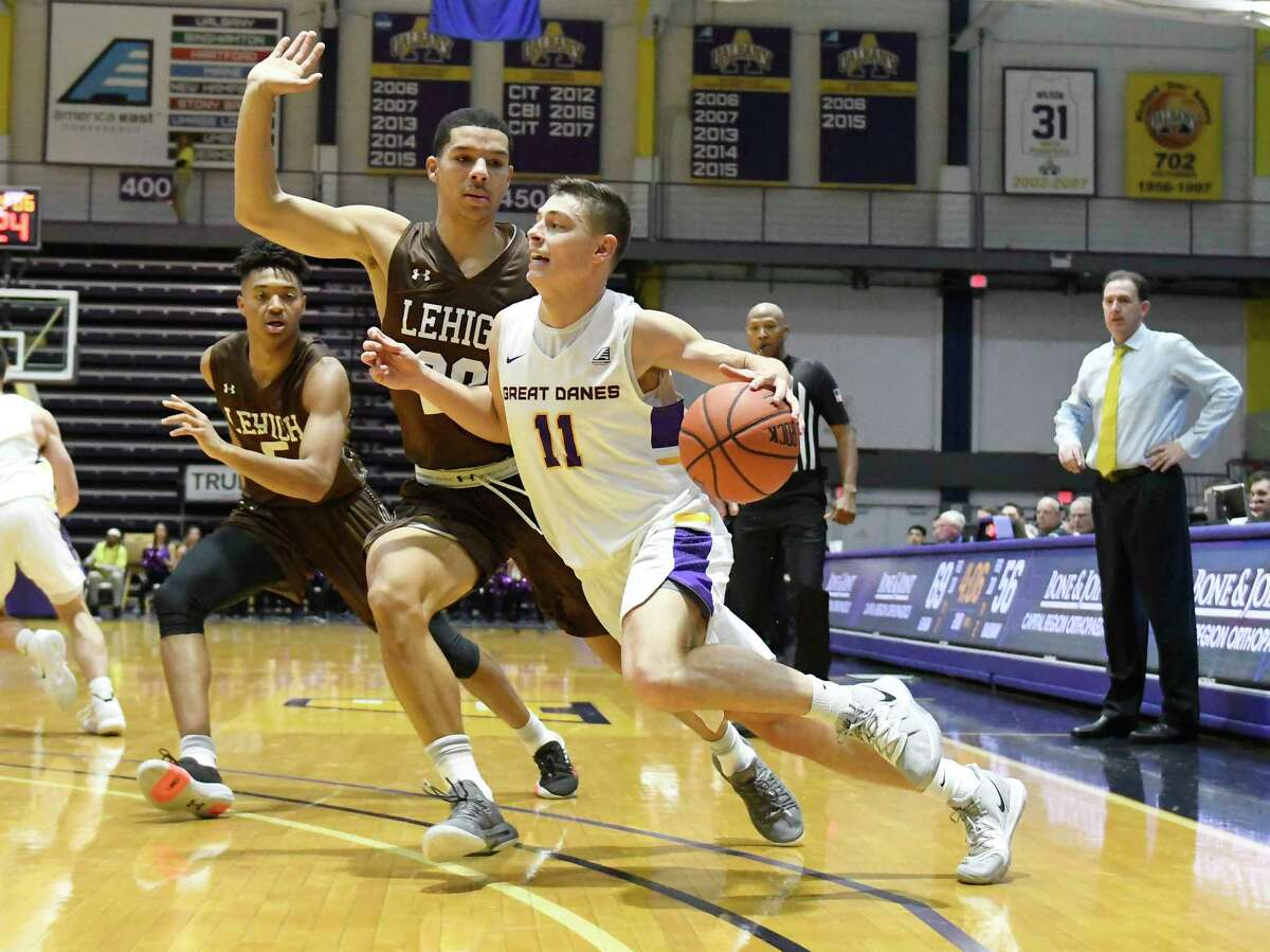 University at Albany guard Cameron Healy (11) moves the ball against Lehigh during the second half of their home opener NCAA basketball game Saturday, Nov. 9, 2019, in Albany, N.Y. Lehigh won 74-70. (Hans Pennink / Special to the Times Union)
