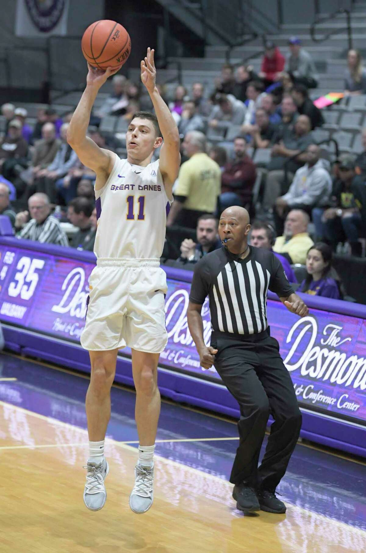 University at Albany guard Cameron Healy (11) scores against Lehigh during the second half of their home opener NCAA basketball game Saturday, Nov. 9, 2019, in Albany, N.Y. Lehigh won 74-70. (Hans Pennink / Special to the Times Union)