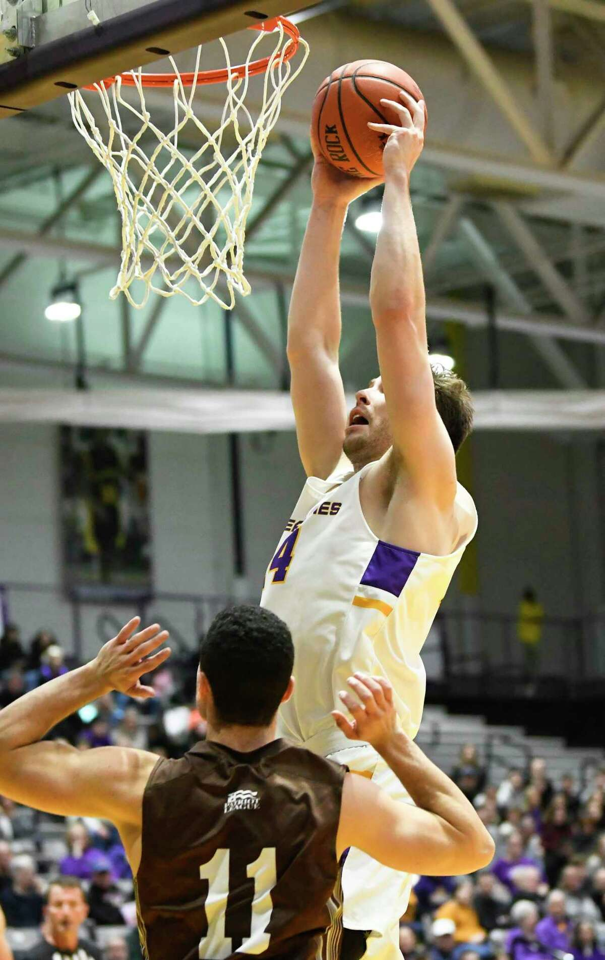 University at Albany forward Adam Lulka (14) scores against Lehigh during the first half of their home opener NCAA basketball game Saturday, Nov. 9, 2019, in Albany, N.Y. (Hans Pennink / Special to the Times Union)
