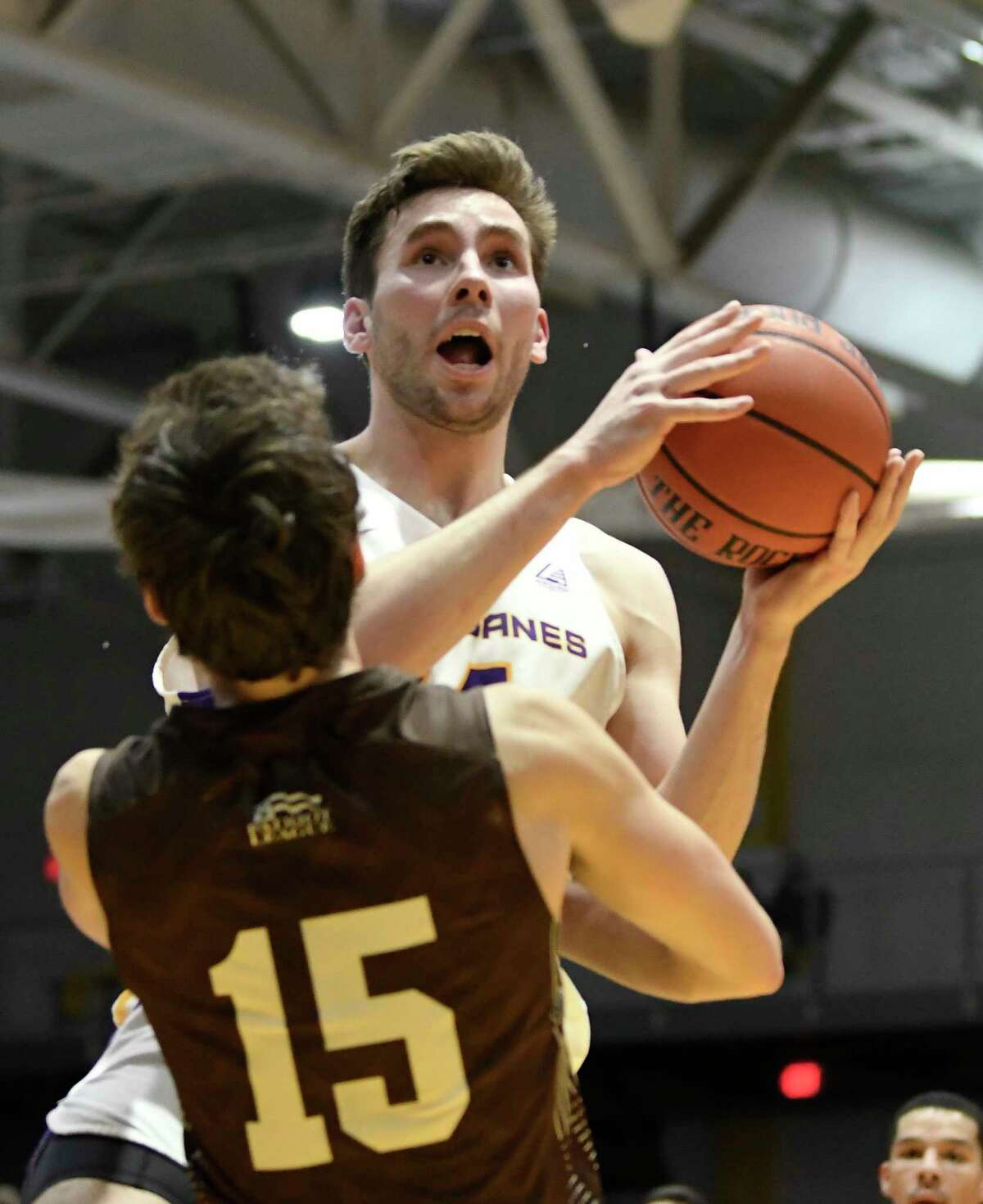 University at Albany forward Adam Lulka (14) puts up a shot over Lehigh guard Reed Fenton (15) during the first half of their home opener NCAA basketball game Saturday, Nov. 9, 2019, in Albany, N.Y. (Hans Pennink / Special to the Times Union)