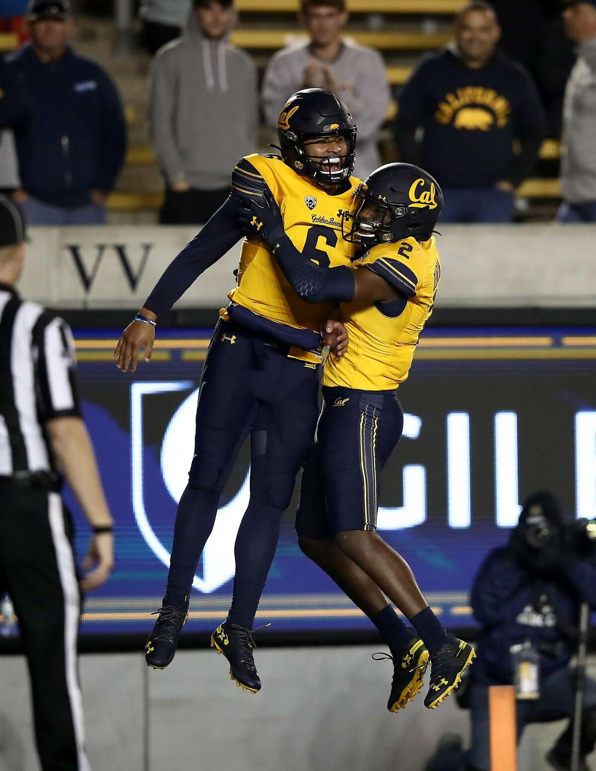 BERKELEY, CALIFORNIA - NOVEMBER 09: Devon Modster #6 of the California Golden Bears is congratulated by Jordan Duncan #2 after Modster ran in for a touchdown against the Washington State Cougars at California Memorial Stadium on November 09, 2019 in Berkeley, California. (Photo by Ezra Shaw/Getty Images)