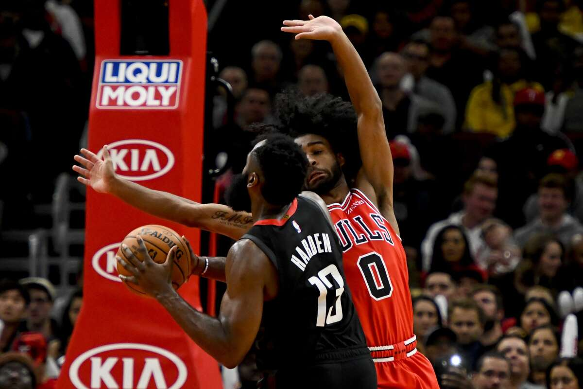 Houston Rockets guard James Harden (13) drives to the basket against Chicago Bulls guard Coby White (0) during the second half of an NBA basketball game Saturday, Nov. 9, 2019, in Chicago. (AP Photo/Matt Marton)