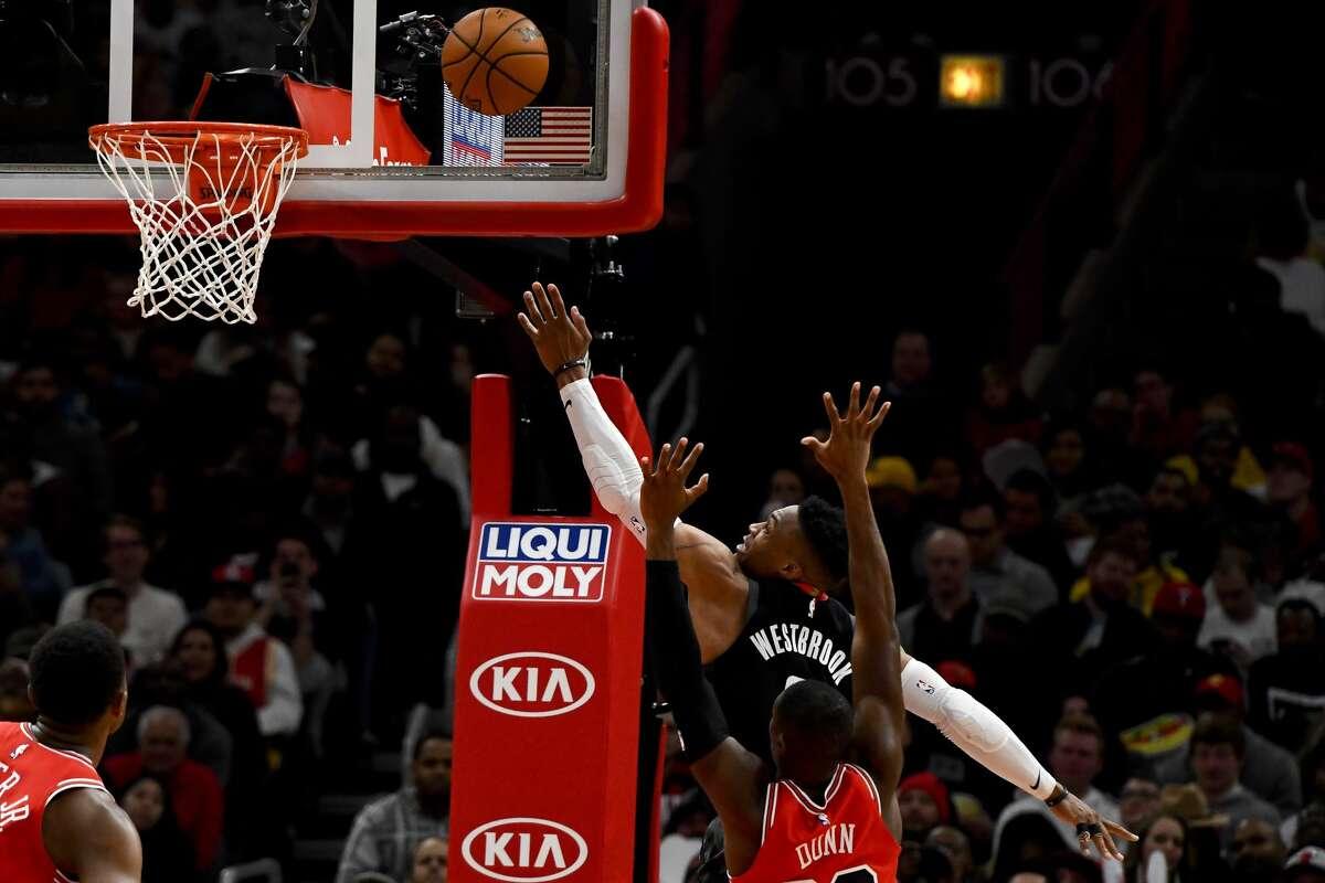 Houston Rockets guard Russell Westbrook (0) shoots past Chicago Bulls guard Kris Dunn, bottom, during the second half of an NBA basketball game Saturday, Nov. 9, 2019, in Chicago. (AP Photo/Matt Marton)