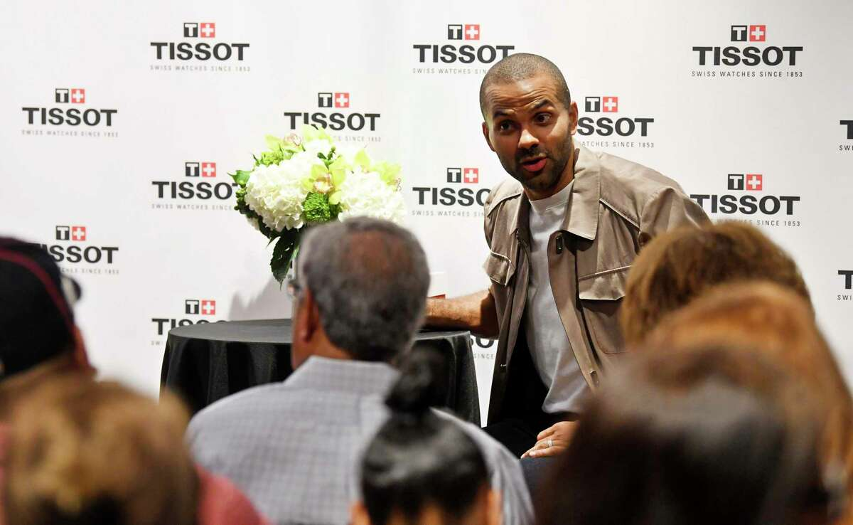 Tony Parker welcomes fans during a meet-and-greet at the North Star Mall Dillard's on Saturday, two days before the Spurs legend's No. 9 jersey will be retired. The line for his three-hour appearance stretched well into the parking lot.