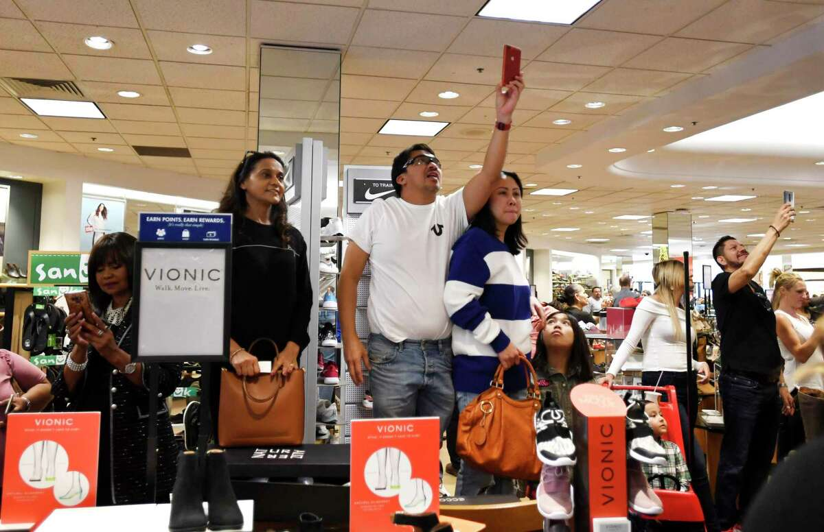 Fans of former San Antonio Spurs point guard Tony Parker shoot pictures of him during an appearance as a Tissot Brand Ambassador at Dillard's in North Star Mall on Saturday, Nov. 9, 2019.