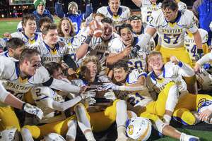 Queensbury celebrates after beating Troy in the Section II, Class A Super Bowl at Shenendehowa High School on Saturday, Nov. 8, 2019 (Jim Franco/Special to the Times Union.)