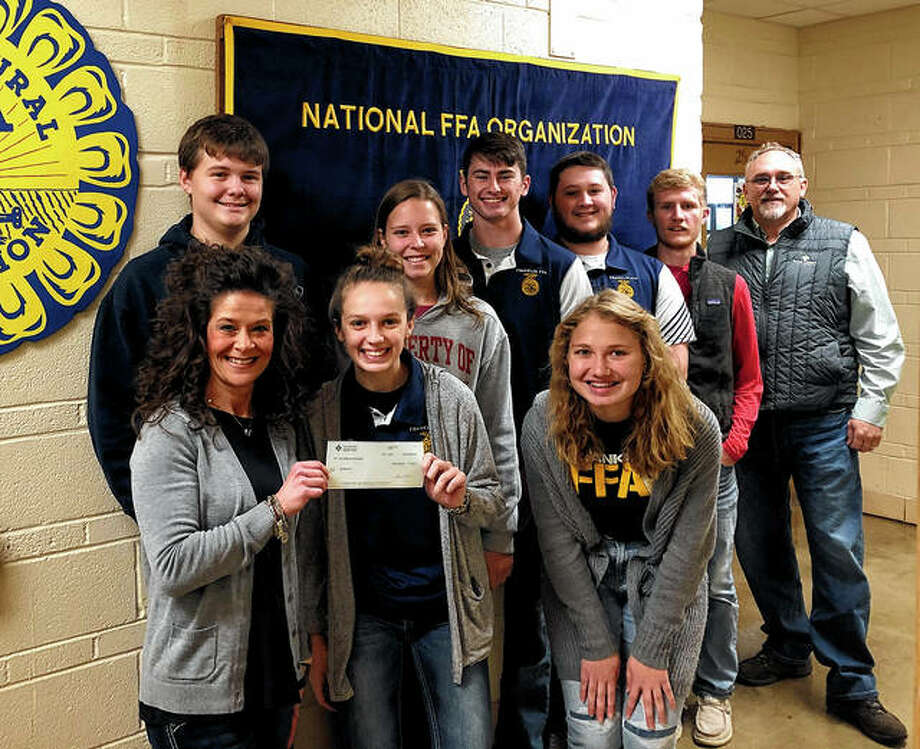 Farm Credit Illinois has made a $500 donation to the Franklin FFA program. The money will be used to support the program and the future of the agriculture industry. Students accepting the donation are Mollie Allen (front row, center) and Bethany Bergschneider (front row, right); Cody Spencer (back row, from left), Abby Crow, Jackson Smith, Kyle Colwell and Ethan Hansell. Photo: Photo Provided