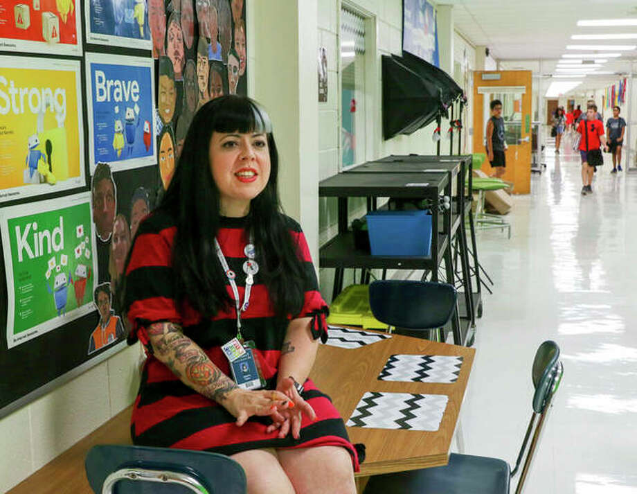 Jen Leban, a sixth- through eighth-grade creative technology teacher at Sandburg Middle School in Elmhurst, waits for students outside her classroom. Photo: Bev Horne | Daily Herald (AP)