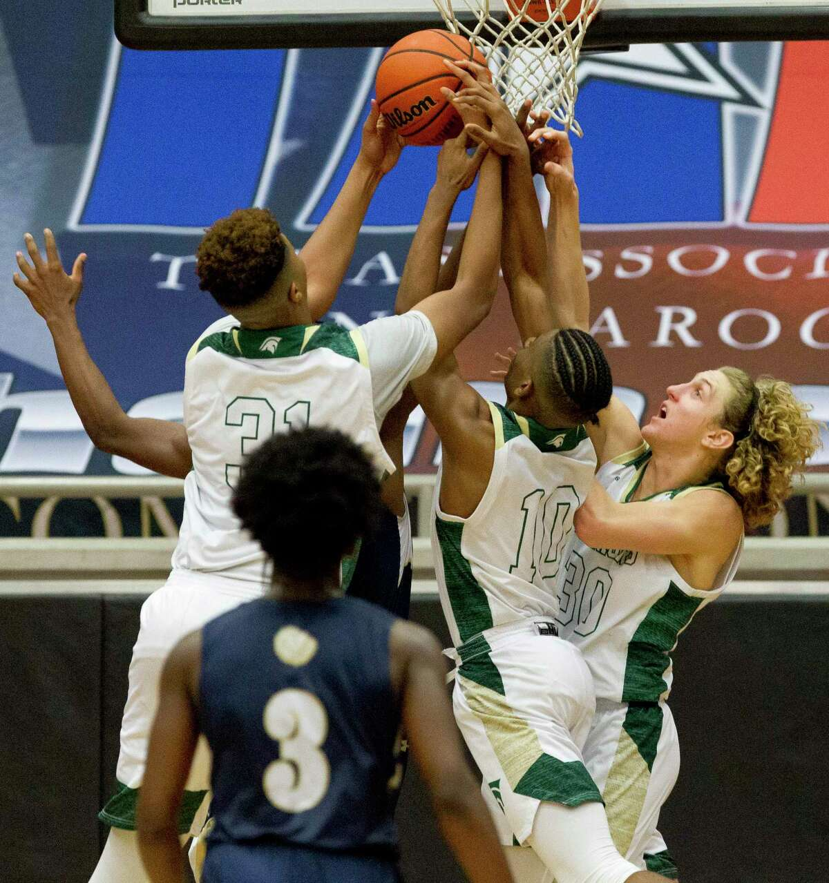 The Woodlands Christian Academy center Emanuel Jones (31), point guard Bakari LaStrap (10) and shooting guard Luke Mansfield (30) are all part of a senior class seeking a second state title.