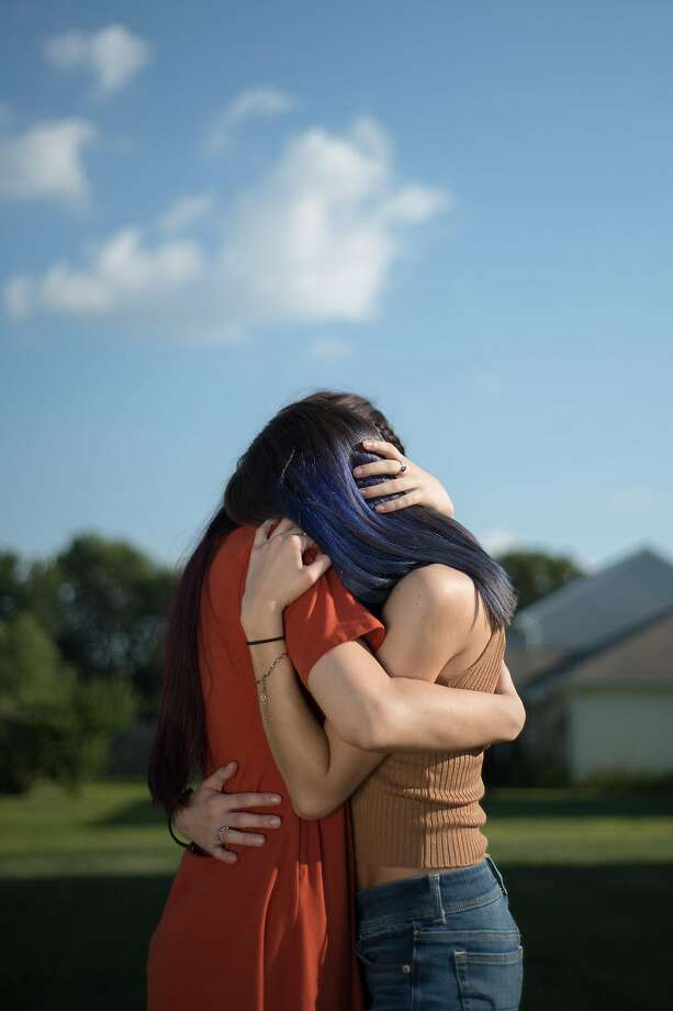 F. and E. (Identities withheld), 17 and 21-year-old sisters from the midwest and survivors of child sexual abuse, in 2019. Online platforms bar child sexual abuse imagery on the web, but criminals are exploiting gaps and the industry has consistently failed to take aggressive steps to shut it down. Victims are caught in a living nightmare, confronting images again and again. (Kholood Eid/The New York Times) Photo: Kholood Eid, NYT