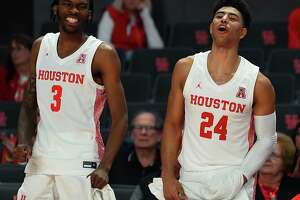Houston guard DeJon Jarreau (3) and Houston guard Quentin Grimes cheer from the sideline during the second half of an NCAA exhibition college basketball game against Angelo State, Saturday, Nov. 9, 2019, in Houston.
