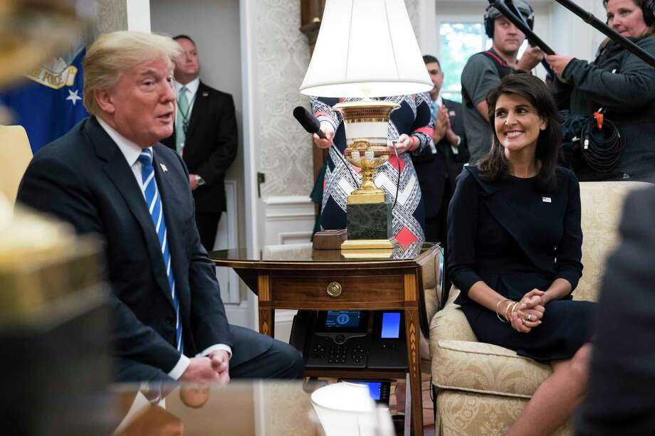 Then-U.S. Ambassador to the United Nations Nikki Haley listens as President Donald Trump speaks during a meeting with UN Secretary General Antonio Guterres in the Oval Office of the White House in October 2017. Photo: Washington Post Photo By Jabin Botsford / The Washington Post