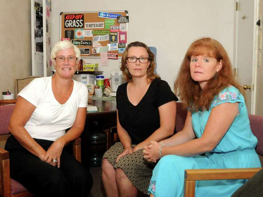 Pamela Walker, left, Liz Jorgensen, center, and Clare Gelissen all work at Insight Counseling in Ridgefield. Jorgensen is a private therapist who specializes in alcohol and substance abuse. Photo: Lisa Weir / The News-Times Freelance