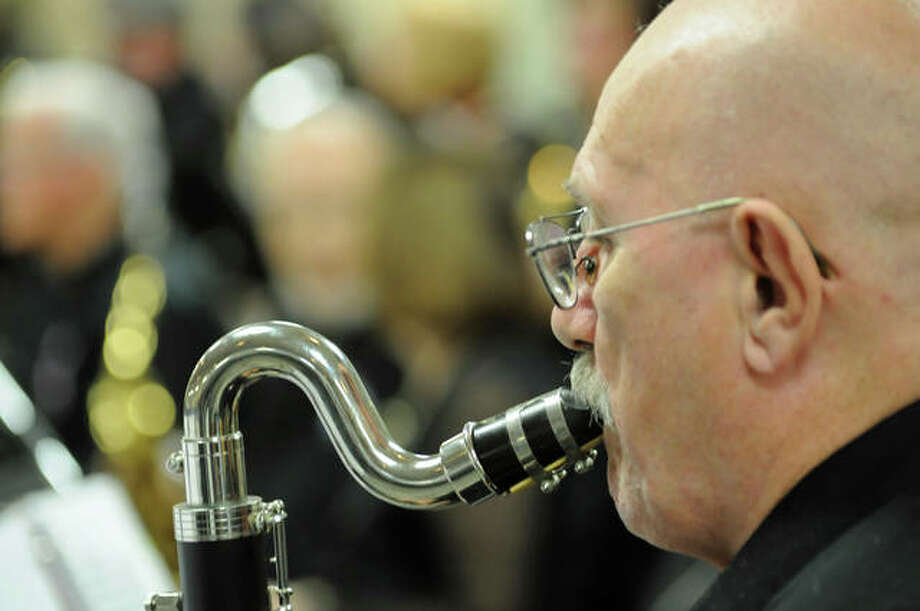 Mike Link, 75, of East Alton plays the bass clarinet Saturday with the New Horizons Band Godfrey. The 50-member band features experienced musicians who meet Monday nights in Godfrey to practice.