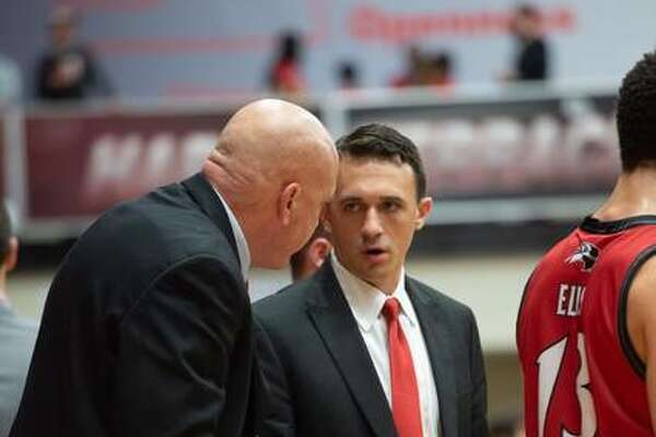 SIUE assistant coach Mike Waldo, left, talks to assistant coach Brian Barone during a game last season. Barone is now the head coach while Waldo is in his second year at SIUE after 30 years as head coach at Edwardsville High School.