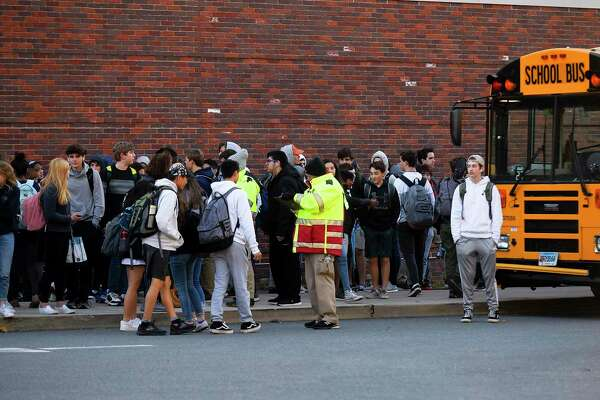 Greenwich High School students wait to board buses at dismissal on Nov. 8, 2019 in Greenwich, Connecticut.