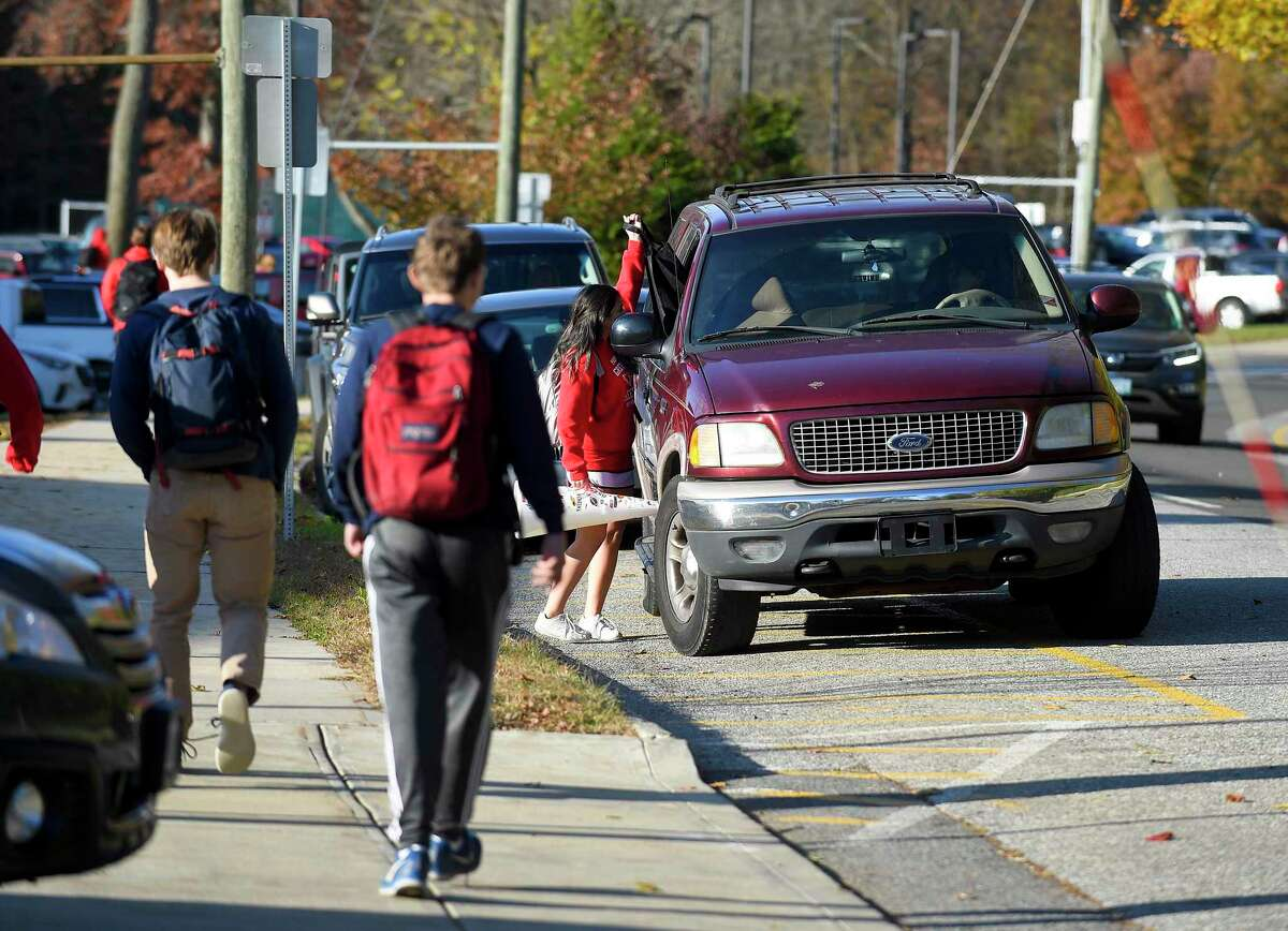 Greenwich High School students walk down Hillside Road to waiting rides at dismissal on Nov. 8, 2019 in Greenwich, Connecticut.