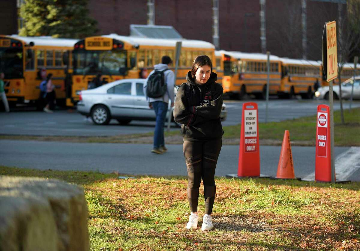 A Greenwich High School student waits for a Uber ride at dismissal on Nov. 8, 2019 in Greenwich, Connecticut.