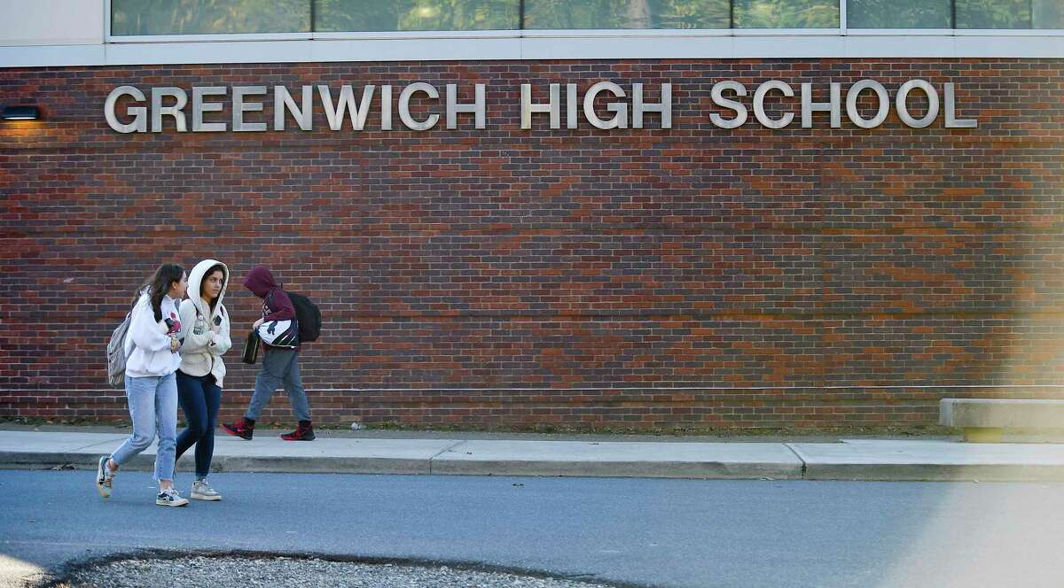 Students pass in front of Greenwich High School at class dismissal on Nov. 8, 2019 in Greenwich, Connecticut.