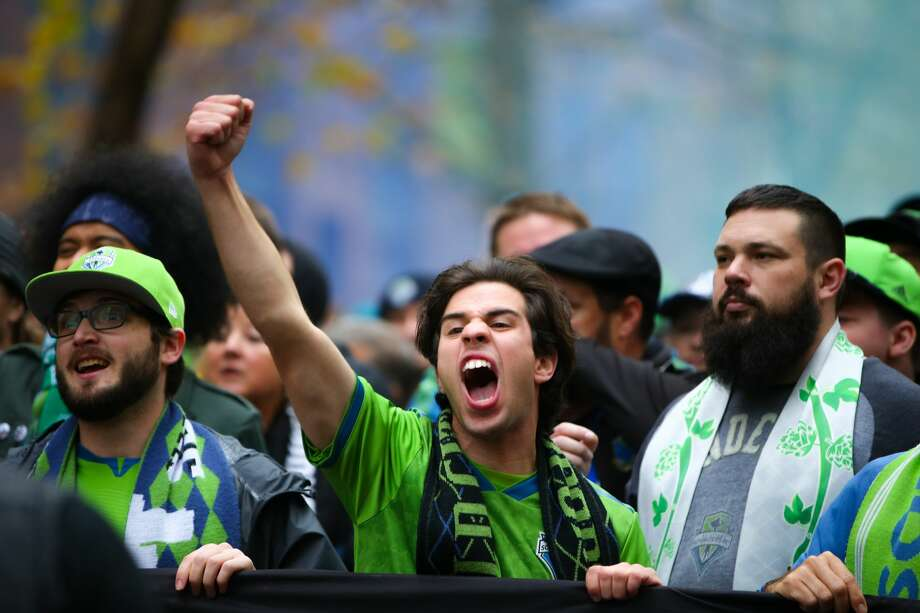 Fans march through Seattle to CenturyLink Field where Seattle Sounders FC hosts Toronto FC for the MLS Finals Cup, Nov. 10, 2019. Photo: Genna Martin, Seattlepi.com