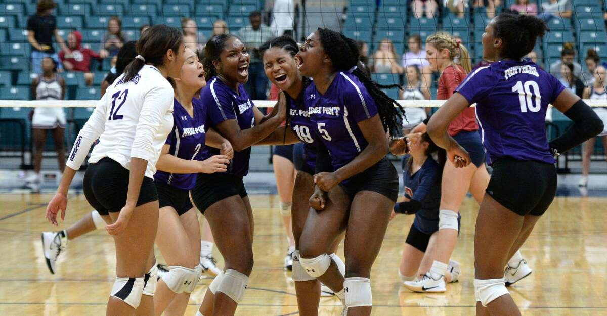 The Ridge Point Panthers celebrate a point during the second set of a Class 6A Region III bi-district volleyball playoff match against the Tompkins Falcons on Tuesday, November 5, 2019 at the Leonard Merrell Center, Katy, TX.