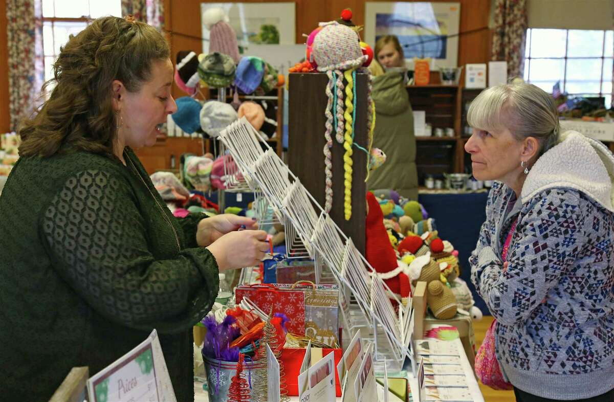 Sara Depeano of Color Street Nail Polish of Stratford, left, talks to Julie Sego of Bridgeport at the Holiday Craft Fair at Jesse Lee United Methodist Church on Saturday, Nov. 9, 2019, in Easton, Conn.